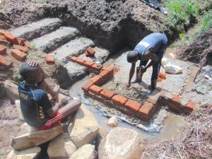The Water Project:  Brick Setting