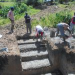 The Water Project: Kalenda B Community, Lumbasi Spring -  Setting Stair Foundatin