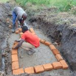 The Water Project: Emurumba Community, Makokha Spring -  Brick Setting