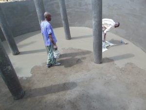 The Water Project:  Plastering Tank Interior