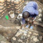 The Water Project: Mwichina Community, Matanyi Spring -  Rub Wall Construction