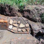 The Water Project: Maondo Community, Ambundo Spring -  Stone Pitching