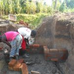 The Water Project: Kalenda B Community, Lumbasi Spring -  Wall Construction