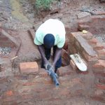 The Water Project: Kitulu Community, Kiduve Spring -  Pipe Setting