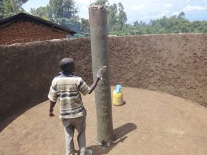 The Water Project:  Plastering Central Pillar
