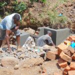 The Water Project: Mwichina Community, Matanyi Spring -  Pipe Setting And Wall Plastering