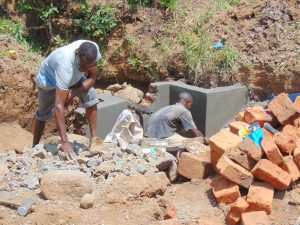 The Water Project:  Pipe Setting And Wall Plastering