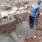 The Water Project: Mubinga Community, Mulutondo Spring -  Headwall Construction