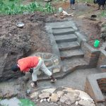 The Water Project: Maondo Community, Ambundo Spring -  Plastering Rub Wall And Stairs