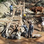 The Water Project: Ngitini Community D -  Building Up The Sand Dam