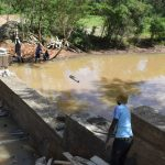 The Water Project: Ngitini Community D -  Dam Begins To Hols Back Water As Construction Nears Completion