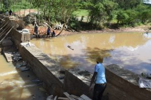 The Water Project:  Dam Begins To Hols Back Water As Construction Nears Completion