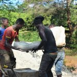 The Water Project: Ngitini Community D -  Hauling Cement