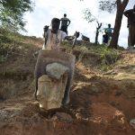 The Water Project: Ngitini Community D -  Hauling Rocks