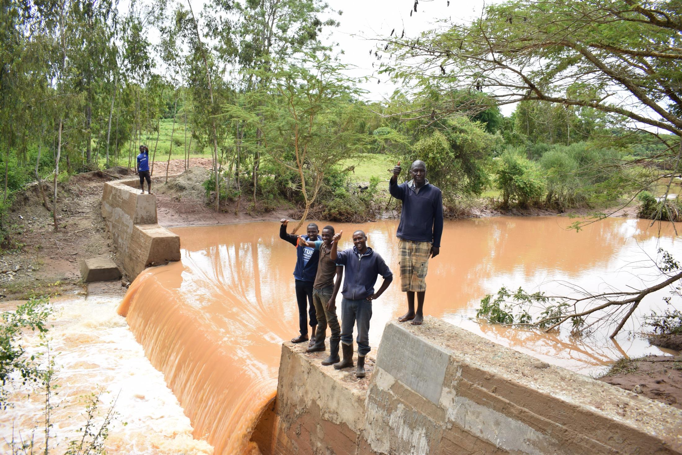 The Water Project : kenya19201-shg-members-at-the-dam