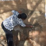 The Water Project: Ngitini Community D -  Working On Dam Wall Cement