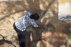 The Water Project:  Working On Dam Wall Cement