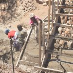 The Water Project: Wamwathi Community -  Adding Rocks To The Wall