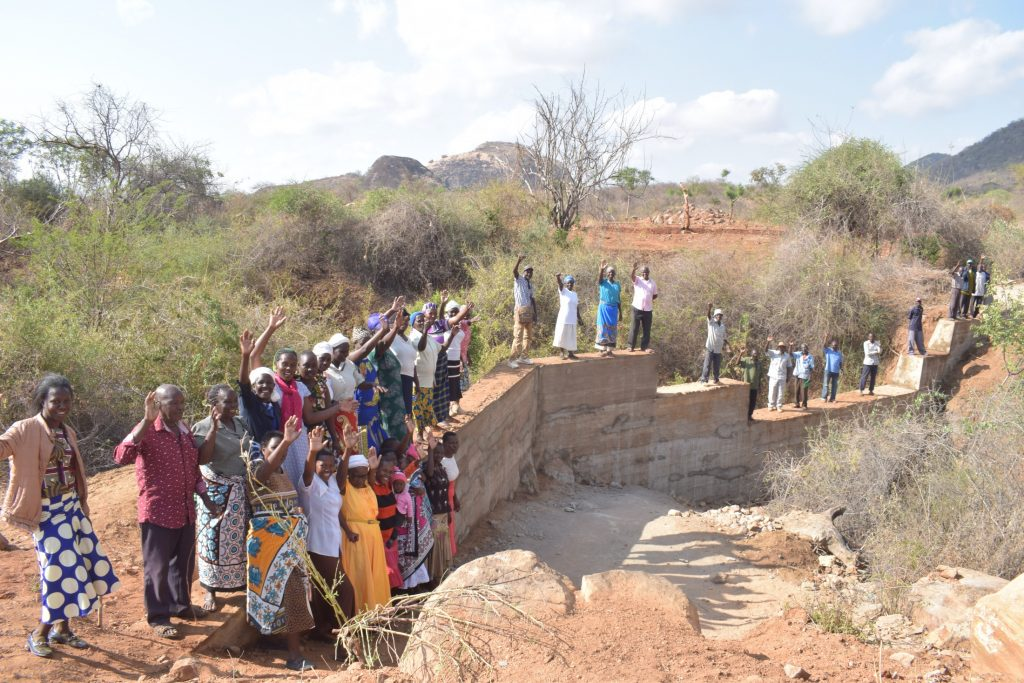 The Water Project : kenya19206-shg-members-at-their-new-dam