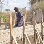 The Water Project: Wamwathi Community -  Working On Wall Cement