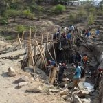 The Water Project: Kyamwao Community -  Building Dam Walls