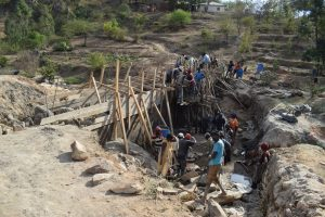 The Water Project:  Building Dam Walls