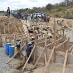 The Water Project: Kyamwao Community -  Building Up Wall Scaffolding
