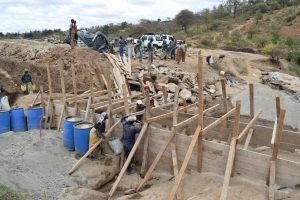 The Water Project:  Building Up Wall Scaffolding