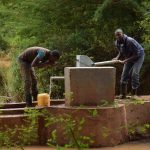 The Water Project: Ngitini Community E -  Drinking Water From The Well