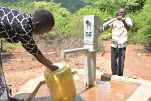 The Water Project:  Pumping At The Well