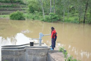 The Water Project:  Pumping New Well