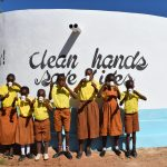 The Water Project: Maviaume Primary School -  Drinking From The Tank Water