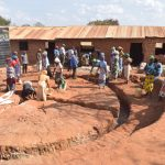 The Water Project: Kyandoa Primary School -  Community Members Working On The Tank