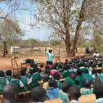 The Water Project: Kyandoa Primary School -  Students Listen At The Training