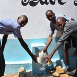 The Water Project: Kithoni Primary School -  Collecting Water At The New Tank