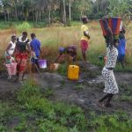 The Water Project: Kamayea, Susu Community & Church -  Community Members Fetching Water For Drilling