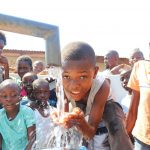 The Water Project: Lungi, 25 Maylie Lane -  Boy Playing With Clean Water
