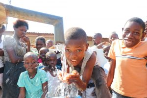 The Water Project:  Boy Playing With Clean Water