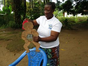 The Water Project:  Diarrhea Doll Demonstration
