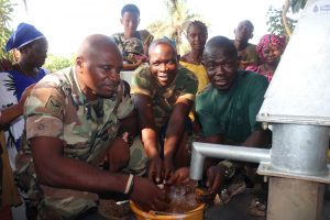 The Water Project:  Military Members Play At The Well