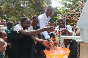 The Water Project:  Head Teacher And Students Splashing Water