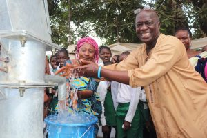 The Water Project:  Head Teacher And Deputy Head Teacher Joyfully Splash Water