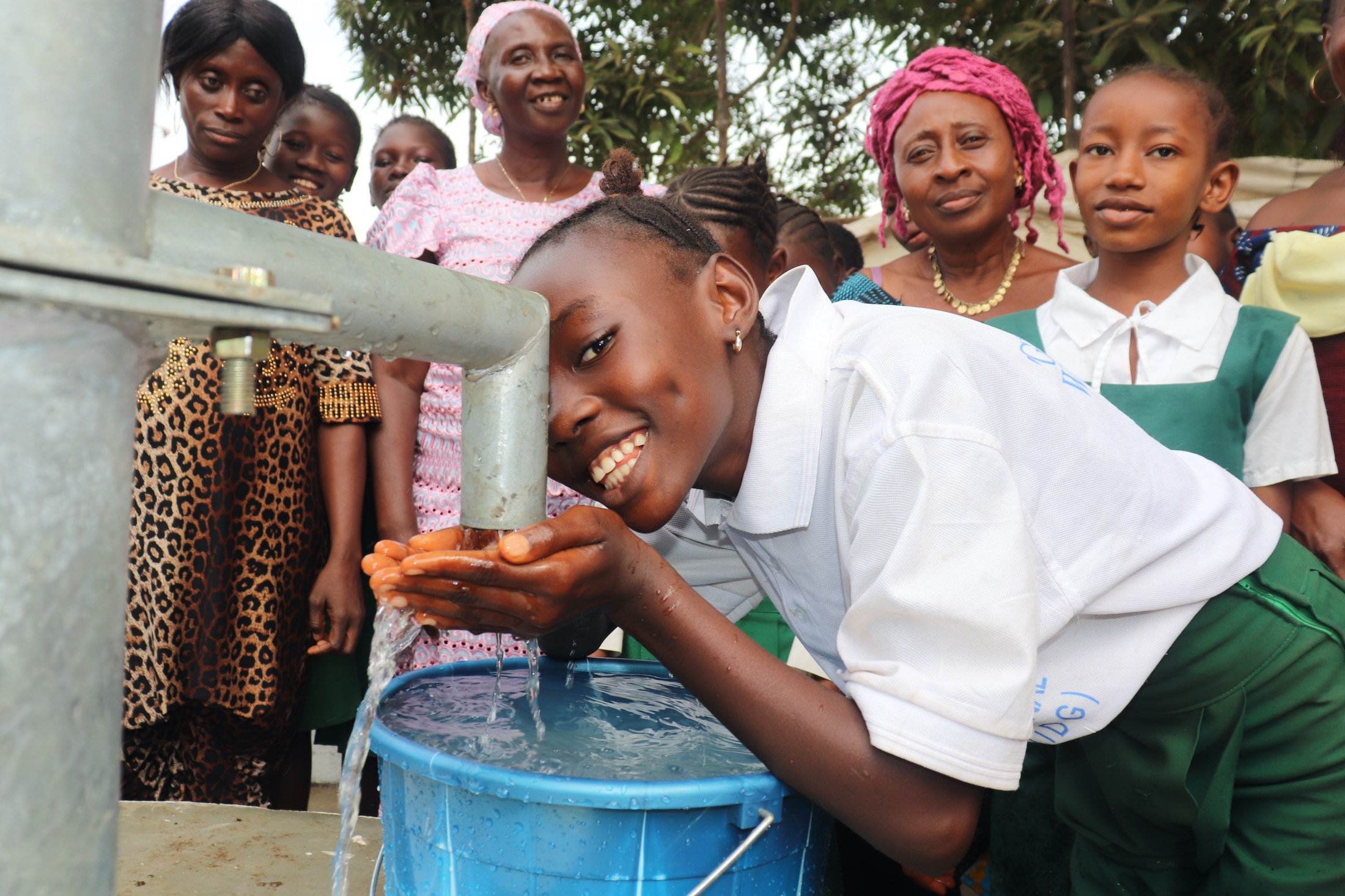 The Water Project : sierraleone20400-happy-student-drinks-from-well