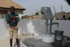 The Water Project:  Happy Student Fetches Water