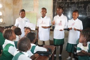 The Water Project:  Students Explaining Disease Transmission