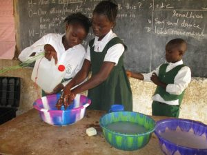 The Water Project:  Students Demonstrating Hand Washing Method With Tippy Tap