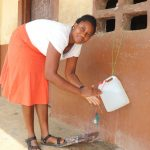 The Water Project: Lungi, Kasongha, DEC Kasongha Primary School -  Teacher Demonstrating Handwashing