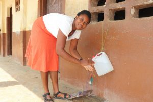 The Water Project:  Teacher Demonstrating Handwashing