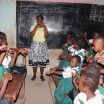 The Water Project: Lungi, Kasongha, DEC Kasongha Primary School -  Teacher Shows Handwashing