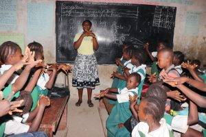 The Water Project:  Teacher Shows Handwashing